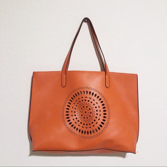 Neiman Marcus Laser Cut Design Orange Leather Tote.  M 5b496664c89e1da2b1db436f 42bd14e08e